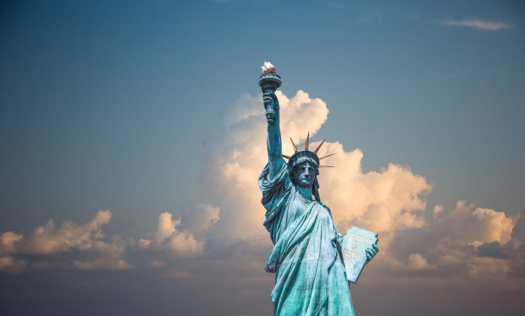 this is the image of the statue of liberty, visiting it is one of the top things to do in new york for first trips